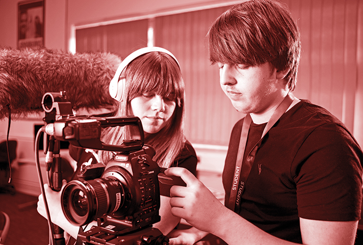 Two filmmaking students behind a camera