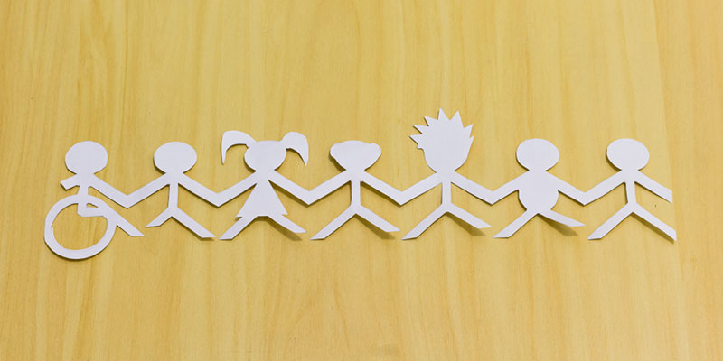 Paper cut out shapes of people